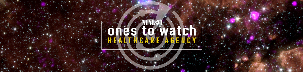 "Background of a star-filled sky featuring the words ""MM&M ones to watch, healthcare agency"