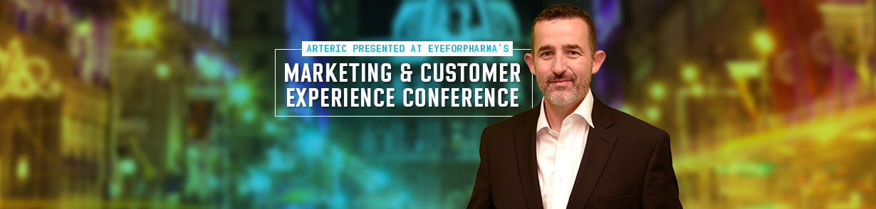 "Hans Kaspersetz in front of Philadelphia scenery and the banner, ""Arteric presented at eyeforpharma's Marketing and Customer Experience Conference"